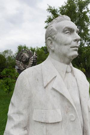 Soviet-Era Sculpture of Alexei Kosygin Former Soviet Premier at Art Muzeon Sculpture Park Photographic Print by Green Light Collection