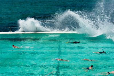Waves Breaking over Edge of Pool of Bondi Icebergs Swim Club, Bondi Beach, Sydney Photographic Print by Green Light Collection