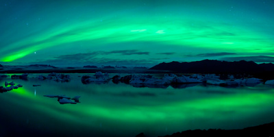 Aurora Borealis or Northern Lights over the Jokulsarlon Lagoon, Iceland Fotografisk tryk af Panoramic Images,