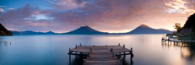 Jetty in a Lake with a Mountain Range in the Background, Lake Atitlan, Santa Cruz La Laguna Fotografisk tryk af Panoramic Images,