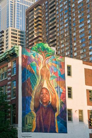Wall Mural of Child Holding Tree in Philadelphia, Pennsylvania Photographic Print