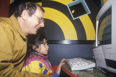 A Girl Learning How to Use a Computer Photographic Print