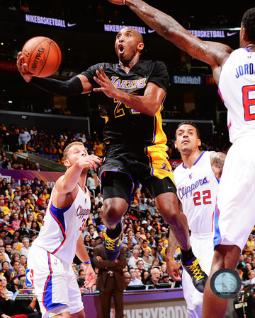 Kobe Bryant shooting basket lay-up dunk in black LA Lakers uniform during 2014-2015 NBA Season against the LA Clippers