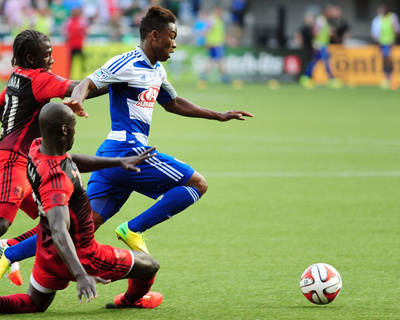 Jun 11, 2014 - MLS: FC Dallas vs Portland Timbers - Diego Chara, Fabian Castillo, Pa Modou Kah Photo by Steve Dykes