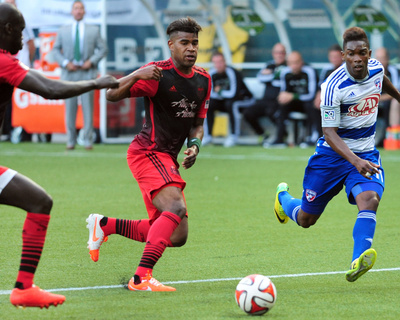 Jun 11, 2014 - MLS: FC Dallas vs Portland Timbers - Fabian Castillo, Pa Modou Kah Photo by Steve Dykes