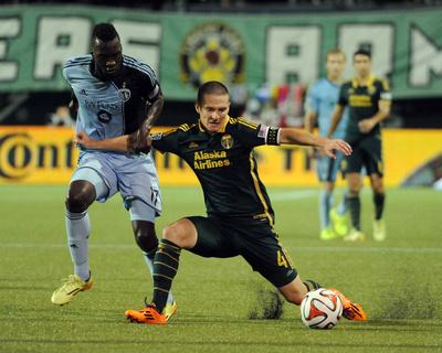 Jun 27, 2014 - MLS: Sporting KC vs Portland Timbers - Will Johnson, C.J. Sapong Photo by Steve Dykes