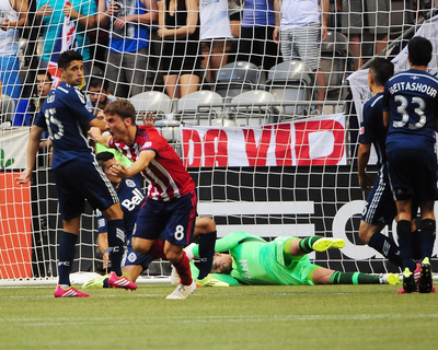 Jul 12, 2014 - MLS: Chivas USA vs Vancouver Whitecaps - Agustin Pelletieri, David Ousted Photo by Anne-Marie Sorvin