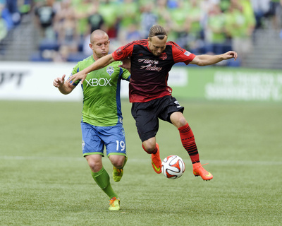 Jul 13, 2014 - MLS: Portland Timbers vs Seattle Sounders - Chad Barrett, Michael Harrington Photo by Steven Bisig