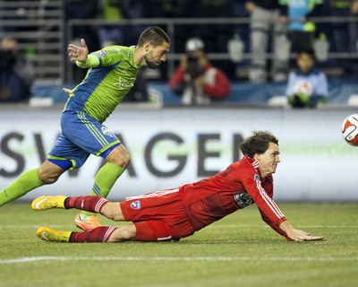 2014 MLS Playoffs: Nov 10, FC Dallas vs Seattle Sounders - Clint Dempsey, Zach Loyd Photo by Joe Nicholson