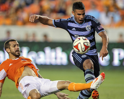 Jun 6, 2014 - MLS: Sporting KC vs Houston Dynamo - Dom Dwyer, Eric Brunner Photo by Troy Taormina