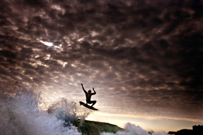 A Young Man Surfs on a Wave on the Outer Banks of North Carolina Photographic Print by Chris Bickford