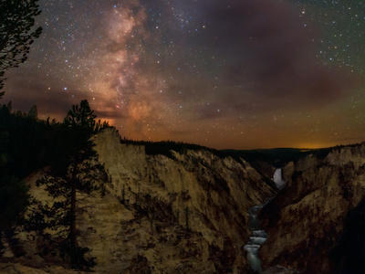 Milky Way in night sky over Lower Falls Grand Canyon of the Yellowstone, Yellowstone River, canyon photo by Babak Tafreshi