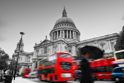 St Paul's Cathedral in London, the Uk. Red Buses in Motion and Man Walking with Umbrella. Photographic Print by PHOTOCREO Michal Bednarek