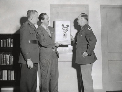 Walt Disney Showing a Sketch of Mickey Mouse Gas Mask to Chemical Warfare Officer Photo