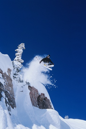 Skier Jumping from Mountain Ledge Photo