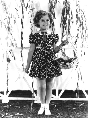 Shirley Temple, Modeling a Red, White and Blue Print Dress with a Blue Velvet Bow, Ca. 1936 Photo