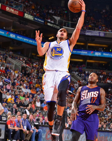 Stephen Curry dunk in Golden State Warriors white uniform against Phoenix Suns basketball sports photo by Barry Gossage