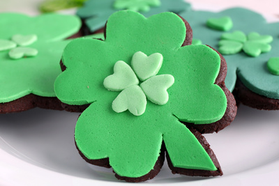 Cookies in Shape of Four Clover Leaf for St Patrick Day Photographic Print by Africa Studio
