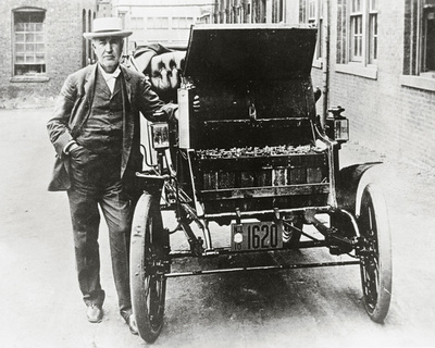 Thomas Edison with his first electric car, the Edison Baker Photo