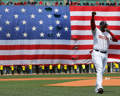 David Ortiz raising hands with U.S. flag salute during game versus the Kansas City Royals photo poster