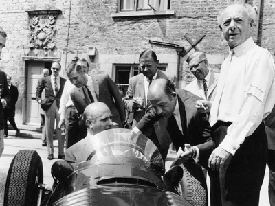 Juan Manuel Fangio at the Wheel of a V16 BRM, 1960s Photographic Print