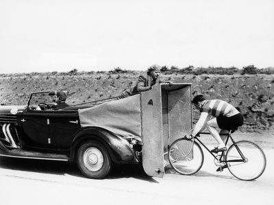 Cyclist Training Behind an Auburn Car, C1935 Photographic Print