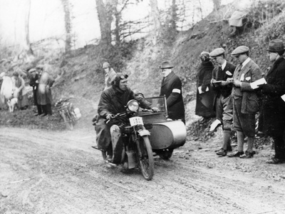 A Competitor Riding a Norton, Competing in the Colmore Cup Trial, 1921 Photographic Print