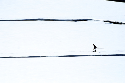 Skiers on the Sunwapta River in Jasper National Park, Alberta Canada Photographic Print by Richard Wright