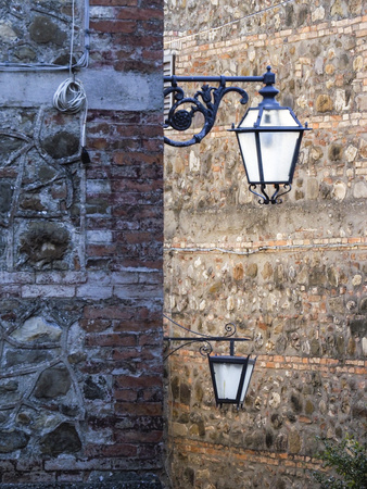 Italy, Tuscany. Lamppost in the Small Medieval Town of Contignano Photographic Print by Julie Eggers
