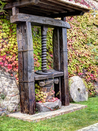 Italy, Tuscany. an Olive Oil Press on Display at a Winery in Tuscany Photographic Print by Julie Eggers