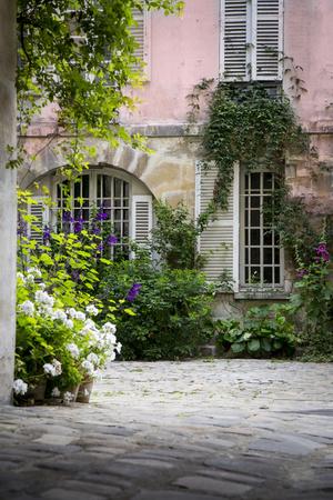 Flowery Building Courtyard in Saint Germaine Des Pres, Paris, France Photographic Print by Brian Jannsen
