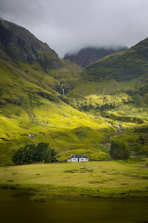 Country Home Below the Mountains of Glencoe, Highlands, Scotland Photographic Print by Brian Jannsen