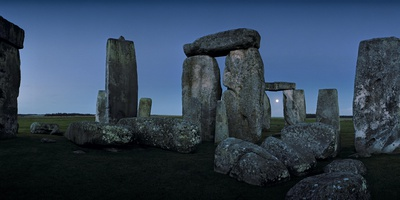A View from the Center Section of Stonehenge with the Moon Seen Through One of the Arches Photographic Print by Macduff Everton