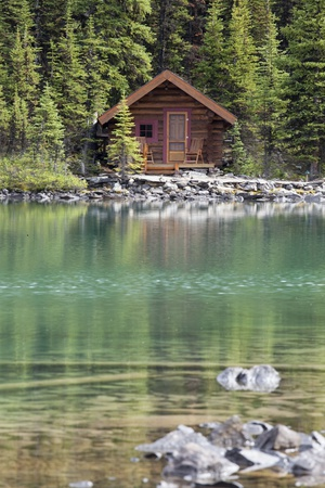 Wooden Cabin Along a Lake Shore Photographic Print by  Design Pics Inc