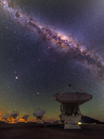 The Milky Way Appears over the Alma Radio Telescopes Photographic Print by Babak Tafreshi