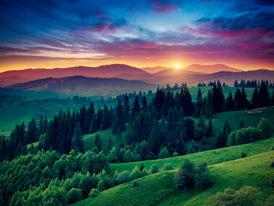 Green Hills Glowing by Warm Sunlight at Twilight. Dramatic Scene. Colorful Sky, Red Clouds. Carpath Photographic Print by Leonid Tit