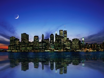 Manhattan shoreline night reflection New York City skyline night photo by Bill Ross