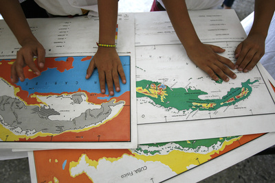 Visually Impaired Boys Touch Cuban Maps in Braille at Abel Santamaria School in Havana Photographic Print by Claudia Daut