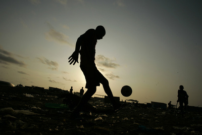 Angolan Youths Play Soccer in the Streets of the Capital Luanda Photographic Print by Rafael Marchante
