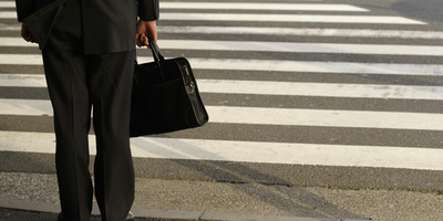 A Businessman Waits to Cross a Street in Tokyo Photographic Print by Yuriko Nakao