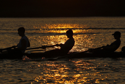 Rowers are Silhouetted During Sunset on the Potomac River in Washington Photographic Print by Molly Riley