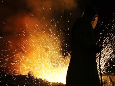 A Labourer Works at a Ferronickel Smelting Furnace in a Fenimak Factory Near Kavadarci Photographic Print by Ognen Teofilovski