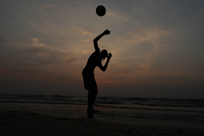 Man Plays Football on Beach in Colombo Photographic Print by Dinuka Liyanawatte
