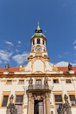 Facade of the Church of Lord Birth (Loreta) in Prague Photographic Print by  joymsk