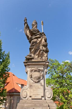 Statue of St. Augustine on Charles Bridge in Prague Photographic Print by  joymsk