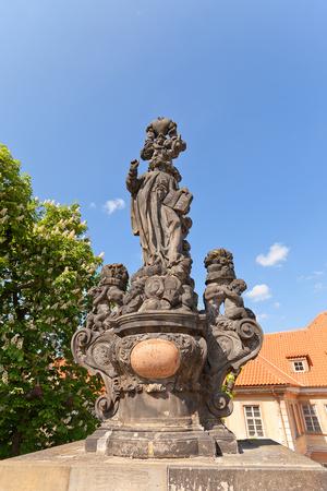 Statue of St. Cajetan on Charles Bridge in Prague Photographic Print by  joymsk