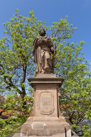 Statue of St. Jude Thaddeus on Charles Bridge in Prague Photographic Print by  joymsk