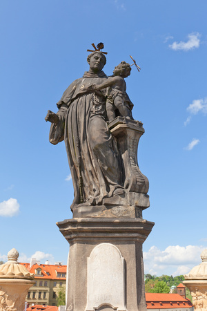 Statue of St. Anthony of Padua on Charles Bridge in Prague Photographic Print by  joymsk