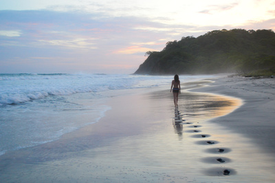 A Girl Walking Down a Tropical Beach in Costa Rica at Sunset Photographic Print by Ben Horton