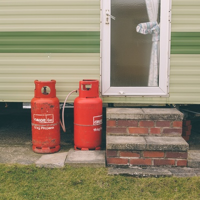 Gas Bottles by Caravan Photographic Print by Clive Nolan